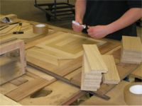 The hand assembling of one Oak prime tile in the pattern Dordt
