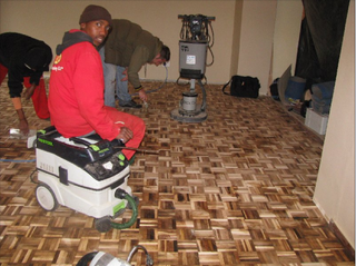 Using wood-filler to fill gaps in tropical parquet floor