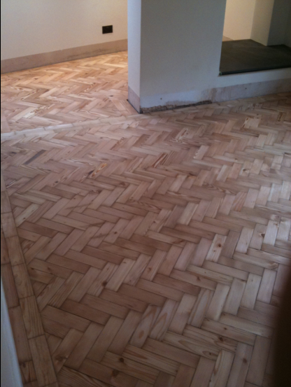 Re-instated herringbone floor by Wood You Like