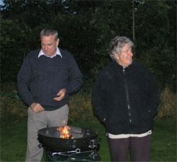 Peter and Sue around our alternative wood stove